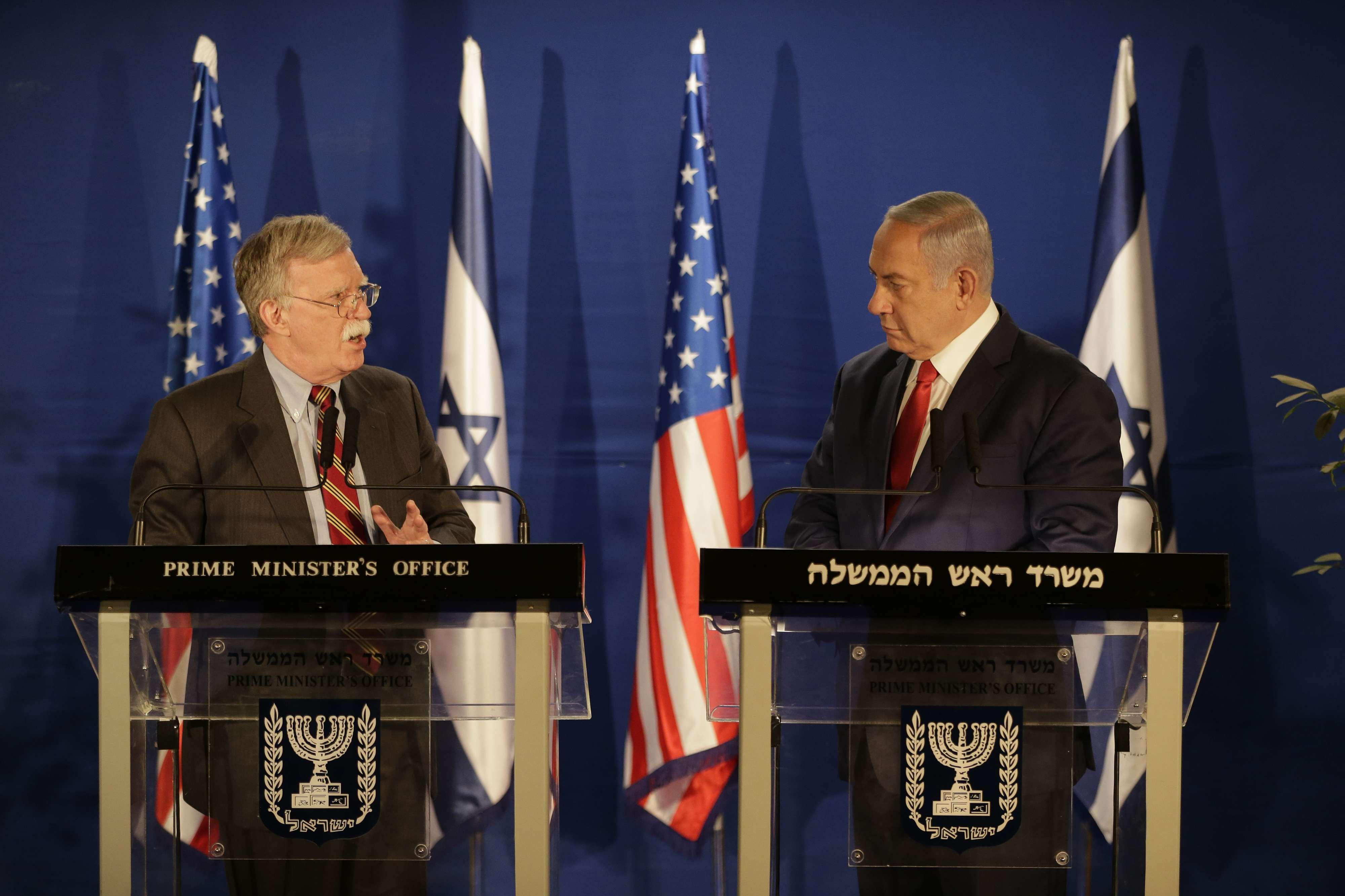 US National Security Advisor John Bolton, left, speaks to Israeli Prime Minister Benjamin Netanyahu during a joint statement to the media follow their meeting, in Jerusalem, Sunday, Jan. 6, 2019. (AP Photo/Oded Balilty, Pool)