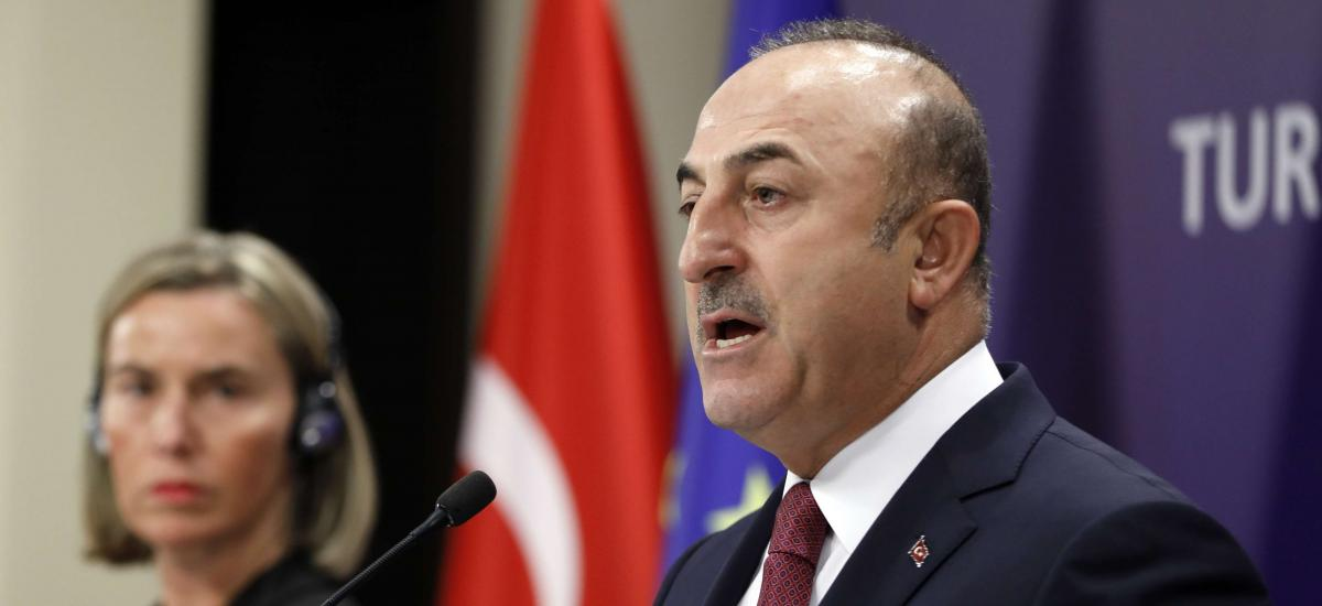 Turkish Foreign Minister Mevlut Cavusoglu, right, speaks during a joint press conference with European Union's foreign policy chief Federica Mogherini after their meeting, in Ankara, Turkey, Thursday, Nov. 22, 2018.