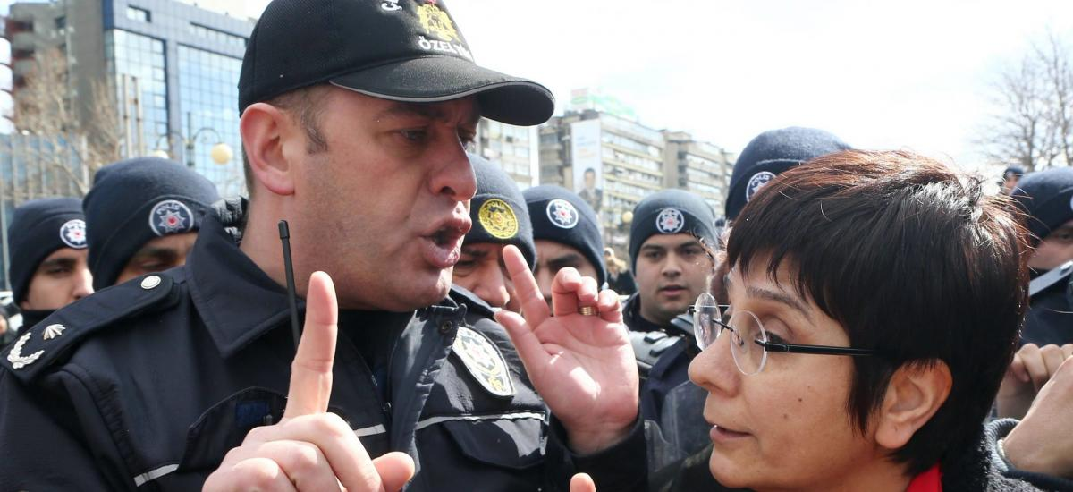 A Turkish police officer argues with a protester as civil society organizations protest against a controversial security bill in Ankara, on March 4, 2015. The ruling Justice and Development Party (AKP) is seeking new ways to speed up legislation of the controversial homeland security package. AFP /ADEM ALTAN