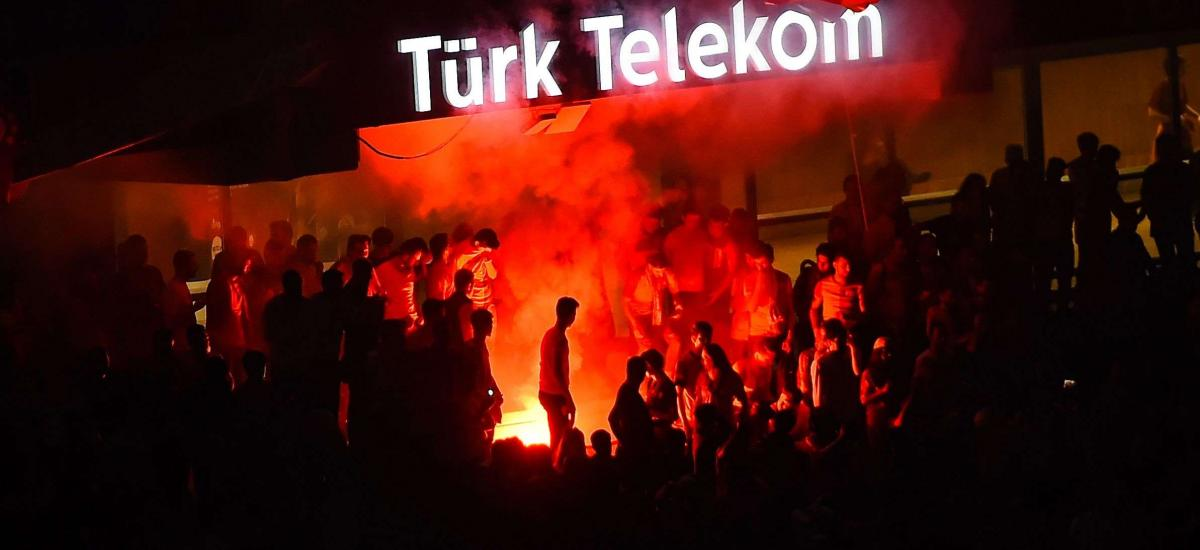 Türk Telekom logo under smoke
