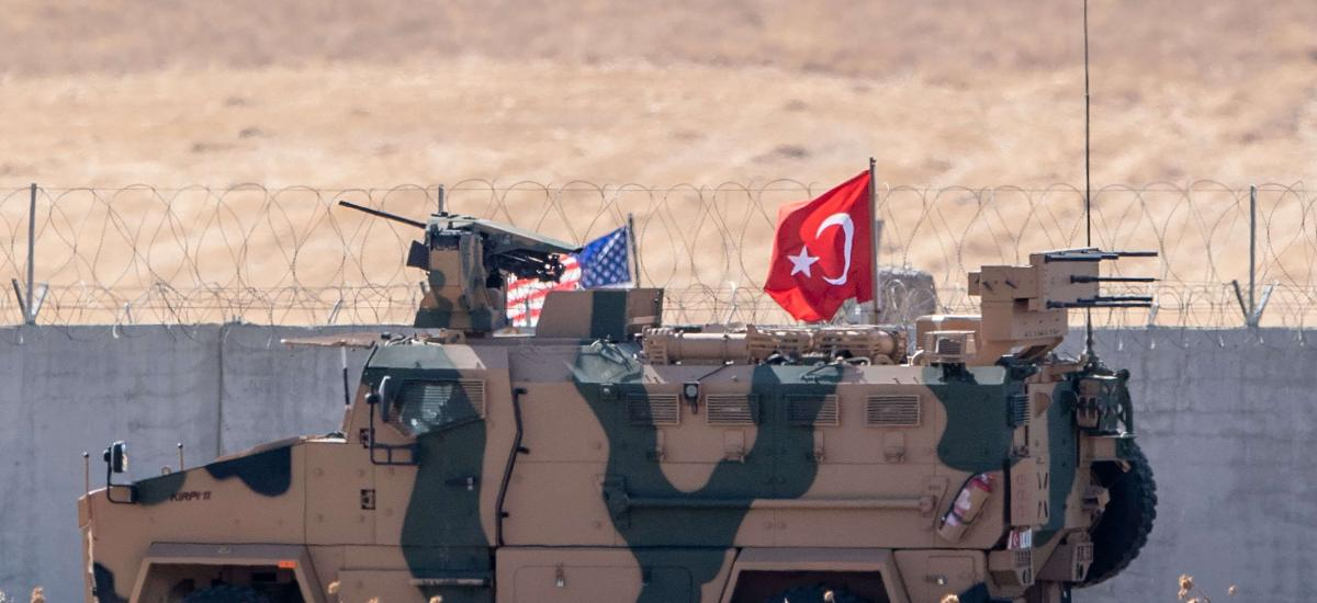 US and Turkish (R) armoured vehicles taking part in their first joint patrol.