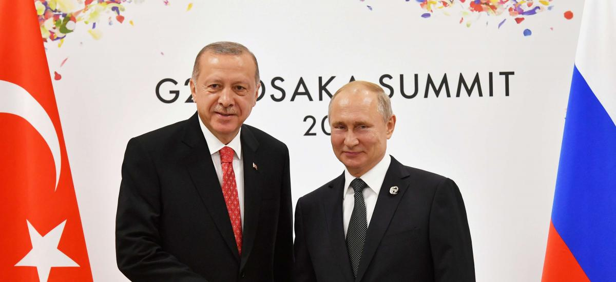 Russian President Vladimir Putin (R) shakes hands with Turkish President Recep Tayyip Erdogan during their bilateral meeting on the sidelines of the G20 leaders summit in Osaka, Japan, on June 29, 2019. Yuri Kadobnov/