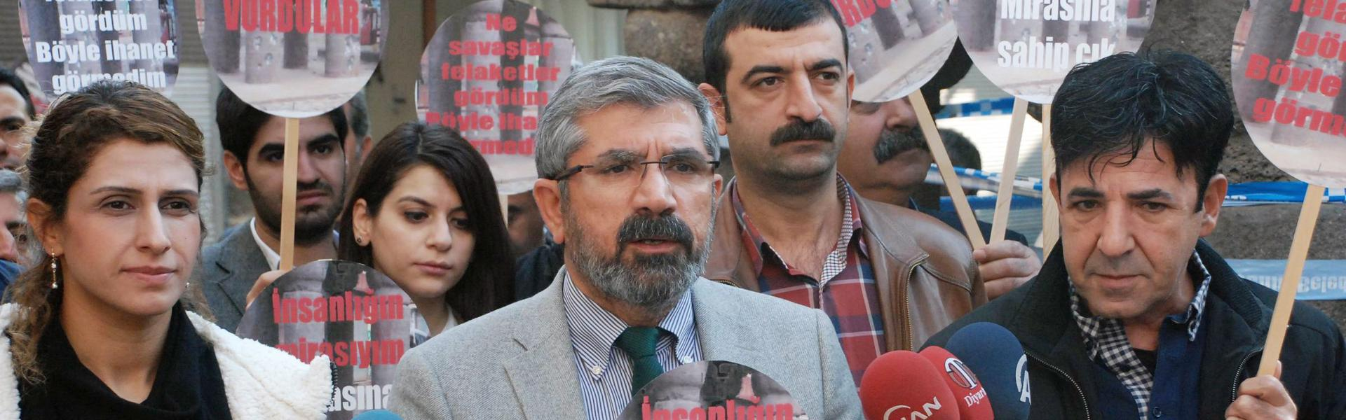 Tahir Elci, the head of Diyarbakir Bar Association, speaks to the media shortly before being killed in Diyarbakir, Turkey, Saturday, Nov. 28, 2015. He was shot while he was making a press statement in front of a historical mosques damaged during fightings between Kurdish rebels and security forces. (IHA agency via AP)