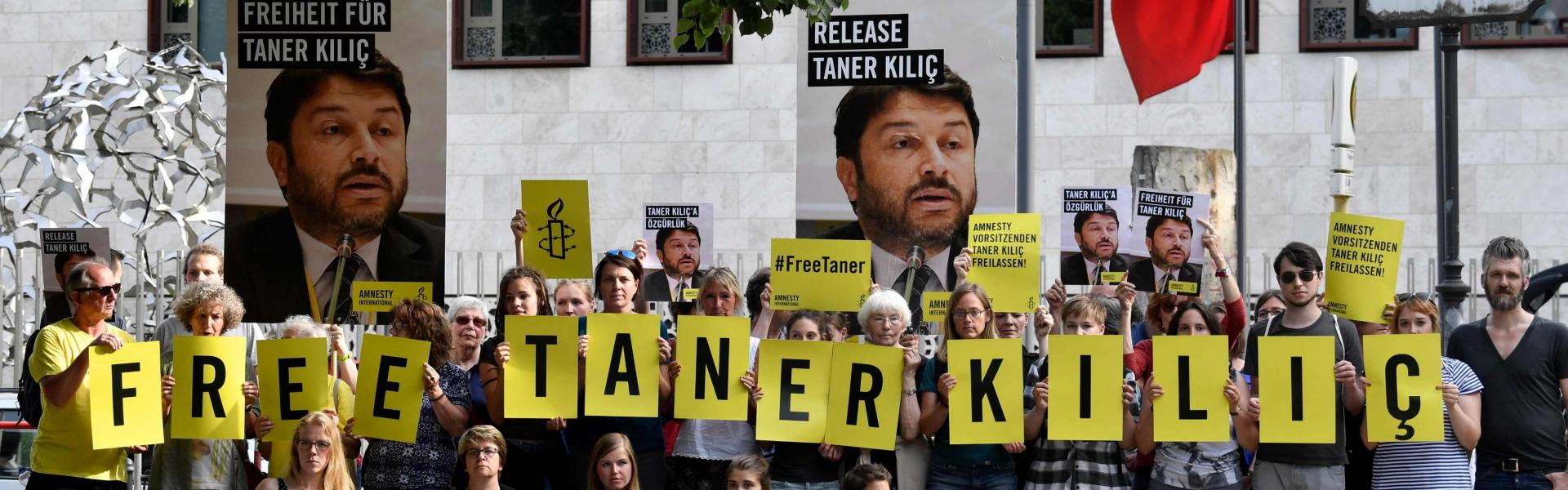 Activists of Amnesty International stage a protest against the detention of the head of Amnesty International in Turkey, Taner Kilic, in front of the Turkish Embassy in Berlin on June 15, 2017. AFP PHOTO / John MACDOUGALL