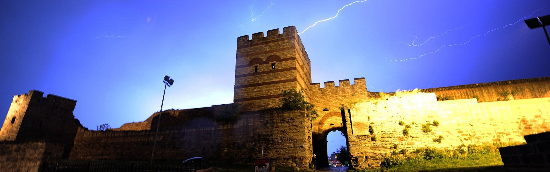 Lightning flashes are pictured during a storm above historical Byzantium walls on May 7, 2015 in Istanbul. AFP PHOTO / OZAN KOSE