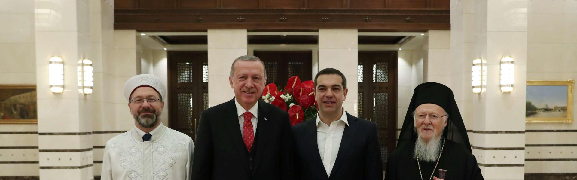 Turkish President Tayyip Erdogan and Greek Prime Minister Alexis Tsipras pose with Ecumenical Patriarch Bartholomew I and Ali Erbas, head of Turkey's Religious Affairs Directorate, after a dinner at the Presidential Palace in Ankara, Turkey, February 5, 2019. Picture taken February 5, 2019. Kayhan Ozer/Presidential Press Office/Handout via REUTERS ATTENTION EDITORS - THIS PICTURE WAS PROVIDED BY A THIRD PARTY. NO RESALES. NO ARCHIVEarabicphoto 20190206034754 reureu horzhorz