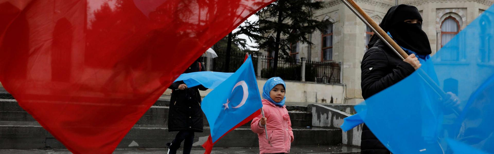 Ethnic Uighur demonstrators hold East Turkestan and Turkish flags during a demonstration against China in Istanbul, Turkey, February 23, 2019. REUTERS/Umit Bektas