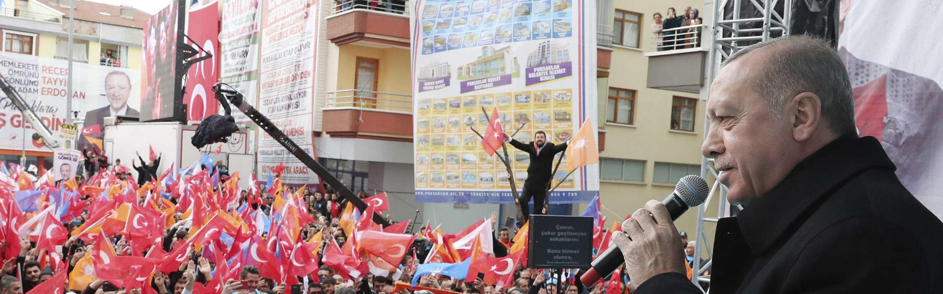 Turkey's President Recep Tayyip Erdogan addresses the supporters of his ruling Justice and Development Party, AKP, during a rally in Ankara, Turkey, Wednesday, March 13, 2019. (Presidential Press Service via AP, Pool)