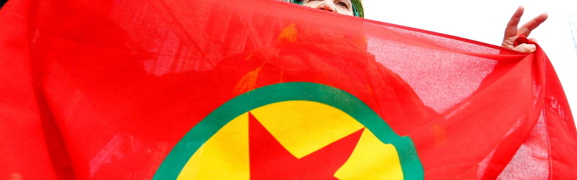 A woman holds a flag of the PKK (Kurdistan Workers' Party) during a demonstration against Turkish President Tayyip Erdogan in central Brussels, Belgium, November 17, 2016. REUTERS/Yves Herman