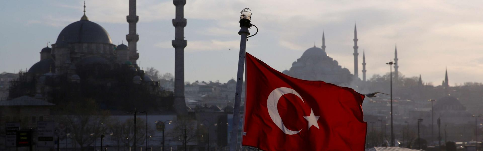 A Turkish flag, with the New and the Suleymaniye mosques in the background, flies on a passenger ferry in Istanbul, Turkey, April 11, 2019. REUTERS/Murad Sezer