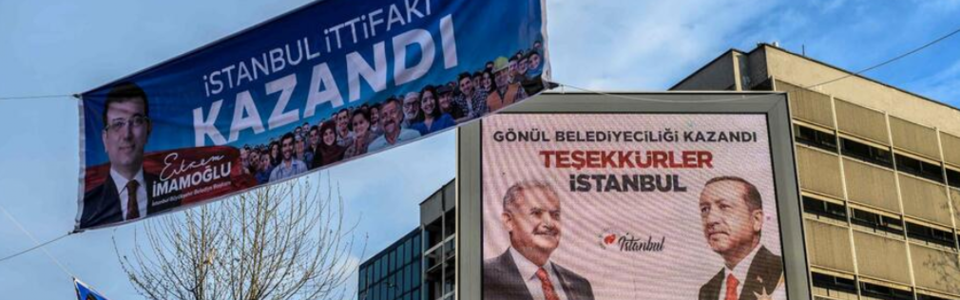 Dueling posters from AKP and CHP in Istanbul after disputed vote