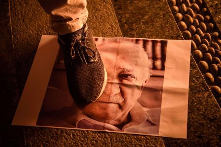 This file photo taken on July 18, 2016 shows a pro-Erdogan supporter stepping on a poster picturing US-based preacher Fethullah Gulen.