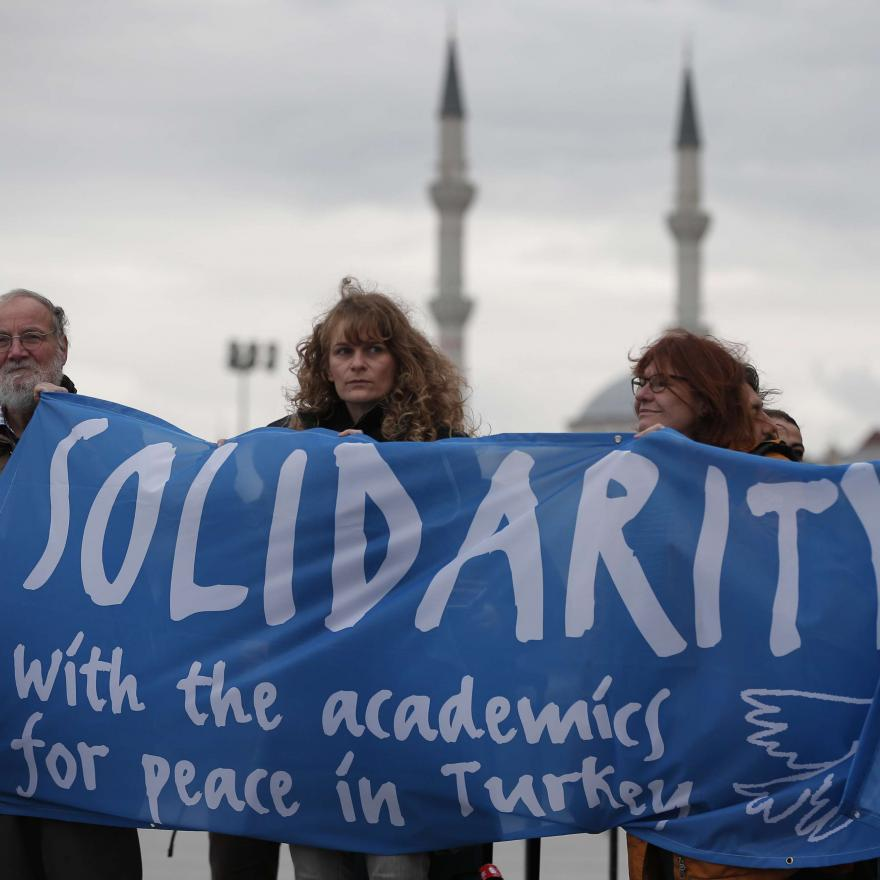 "A delegation of academics and human rights activists from Germany participate in a protest outside a court in Istanbul, Tuesday, Dec. 5, 2017, where Turkish ""Academics for Peace"" went on trial for signing a declaration calling for end of hostilities in Turkey's southeast. (AP Photo/Lefteris Pitarakis)"