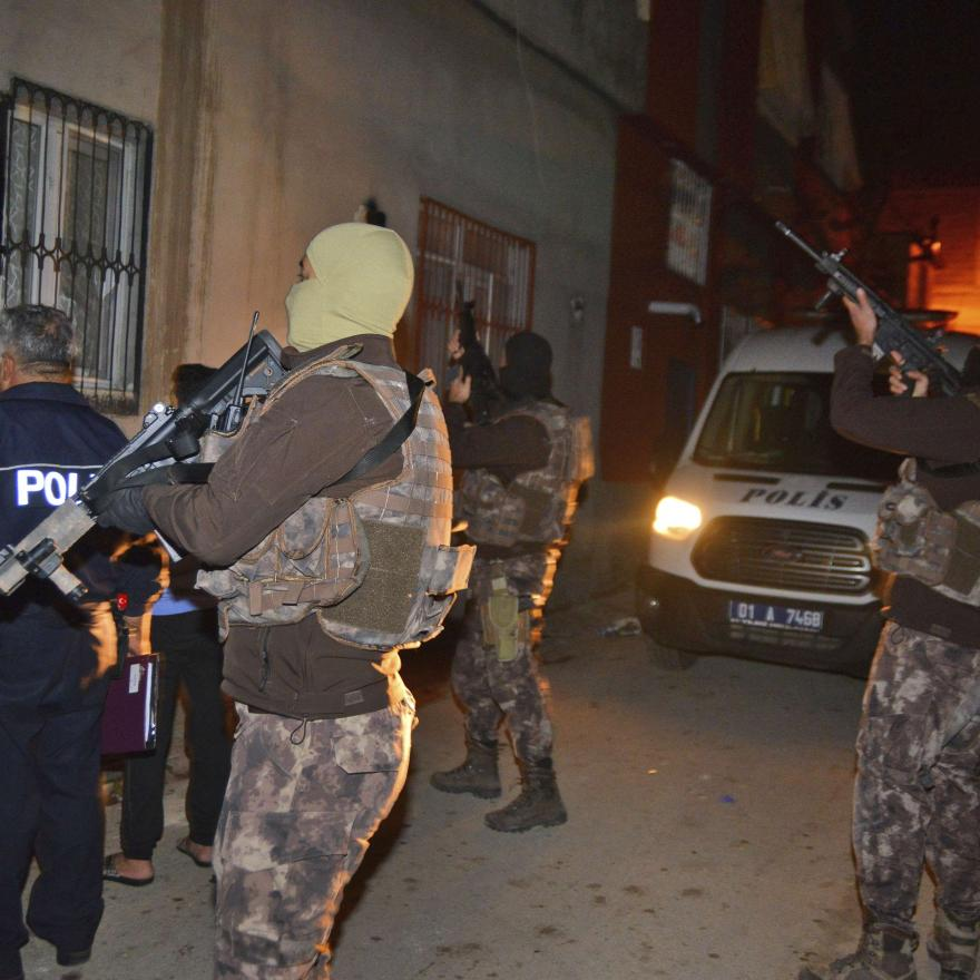 File: Masked Turkish police officers secure the perimeter outside a house during an operation to arrest people for alleged links to Islamic State group in Adana, Turkey, early Friday, Nov. 10, 2017. (Gokhan Kesici/DHA-Depo Photos via AP)