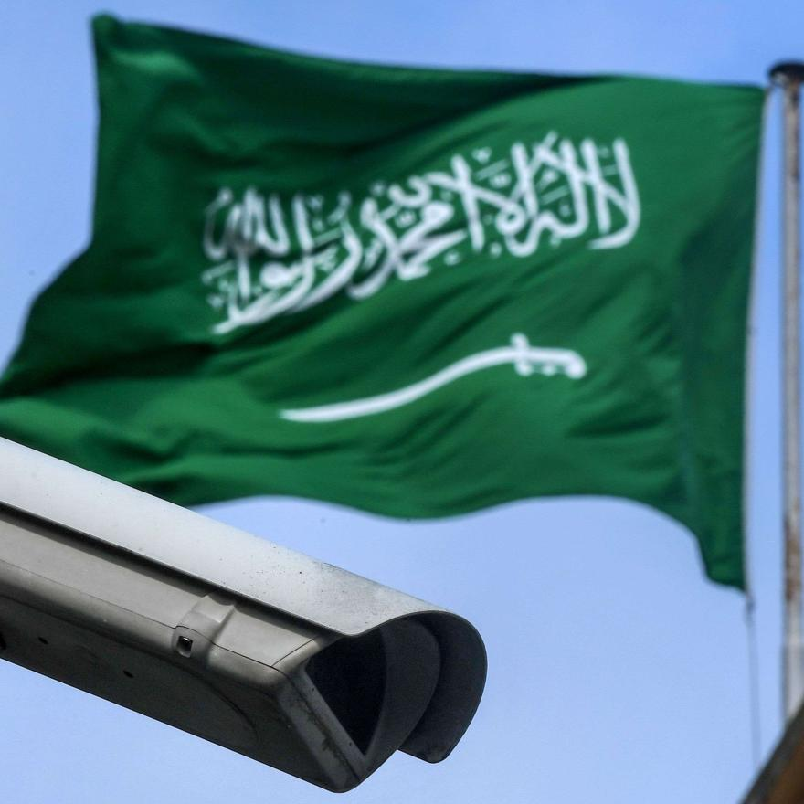 This picture shows a Saudi Arabia flag and a video camera surveillance at the backyard of the Saudi Arabian consulate on October 11, 2018 in Istanbul. - Jamal Khashoggi, a Saudi Washington Post contributor, vanished on October 2 after entering the consulate to obtain official documents ahead of his marriage to his Turkish fiancee. Government sources said at the weekend that police believed Khashoggi was killed by a team specially sent to Istanbul, thought to consist of 15 Saudis. Turkish President Recep Tay