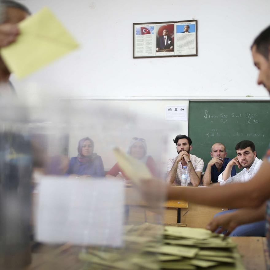 Political parties representatives watch votes being counted at a polling station in the mainly-Kurdish city of Diyarbakir, southeastern Turkey, Sunday, June 24, 2018. AP Photo/Emre Tazegul