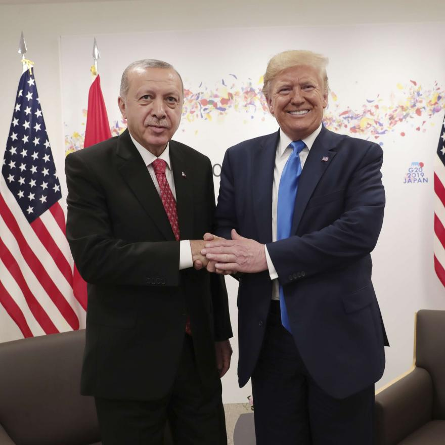 Turkey's President Recep Tayyip Erdogan, left, and U.S. President Donald Trump, right, shake hands during a meeting on the sidelines of the G-20 summit in Osaka, Japan, Saturday, June 29, 2019. (Presidential Press Service/Pool Photo via AP)
