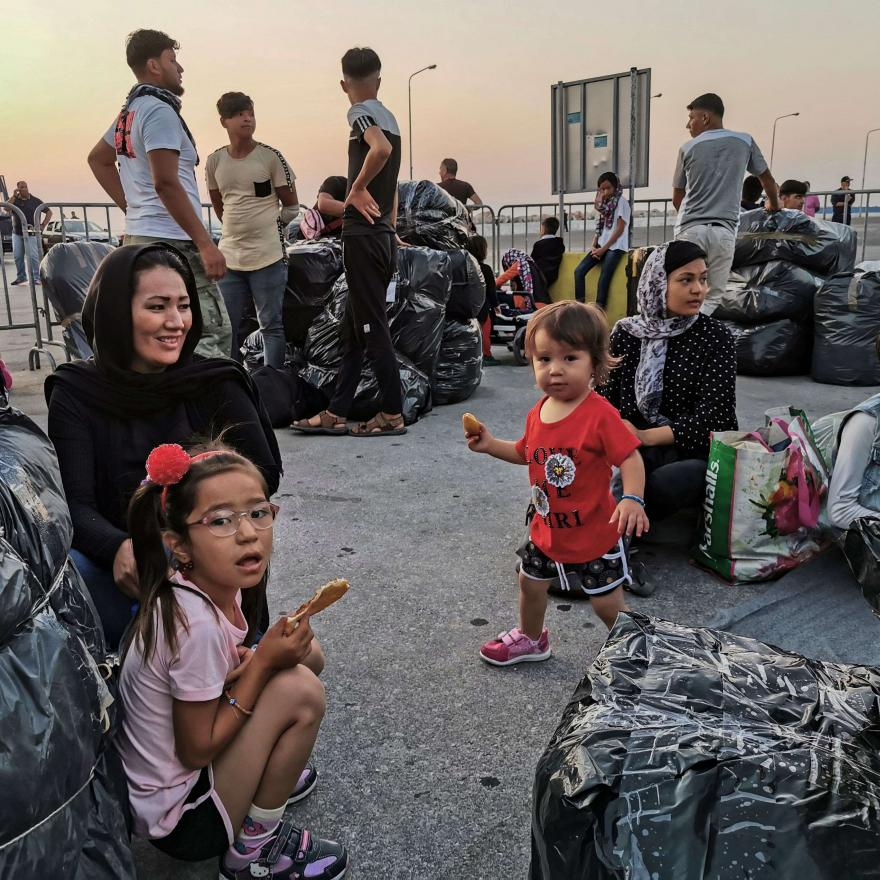 Refugees and migrants wait to board on a ship at the port of Mytilene, in the island of Lesbos on September 2, 2019. Stringer/AFP