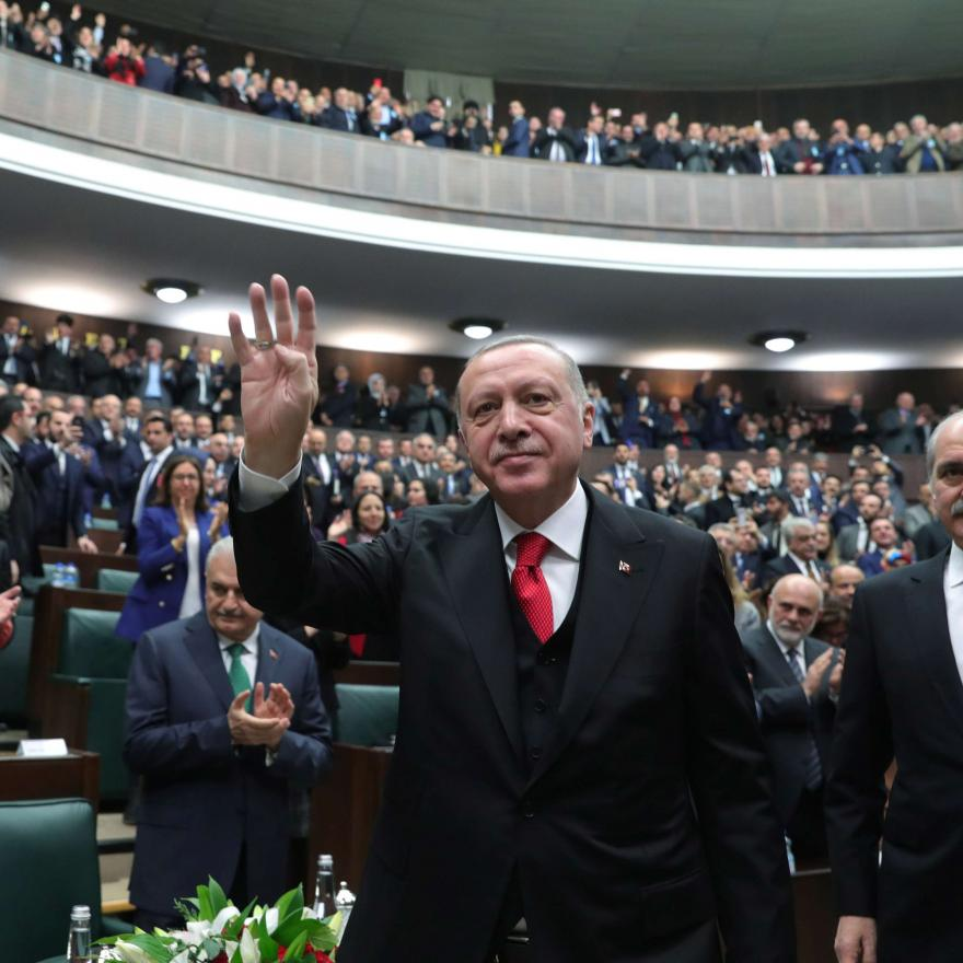 Turkish President Tayyip Erdogan greets members of his ruling AK Party at the parliament in Ankara, Turkey, February 12, 2020.