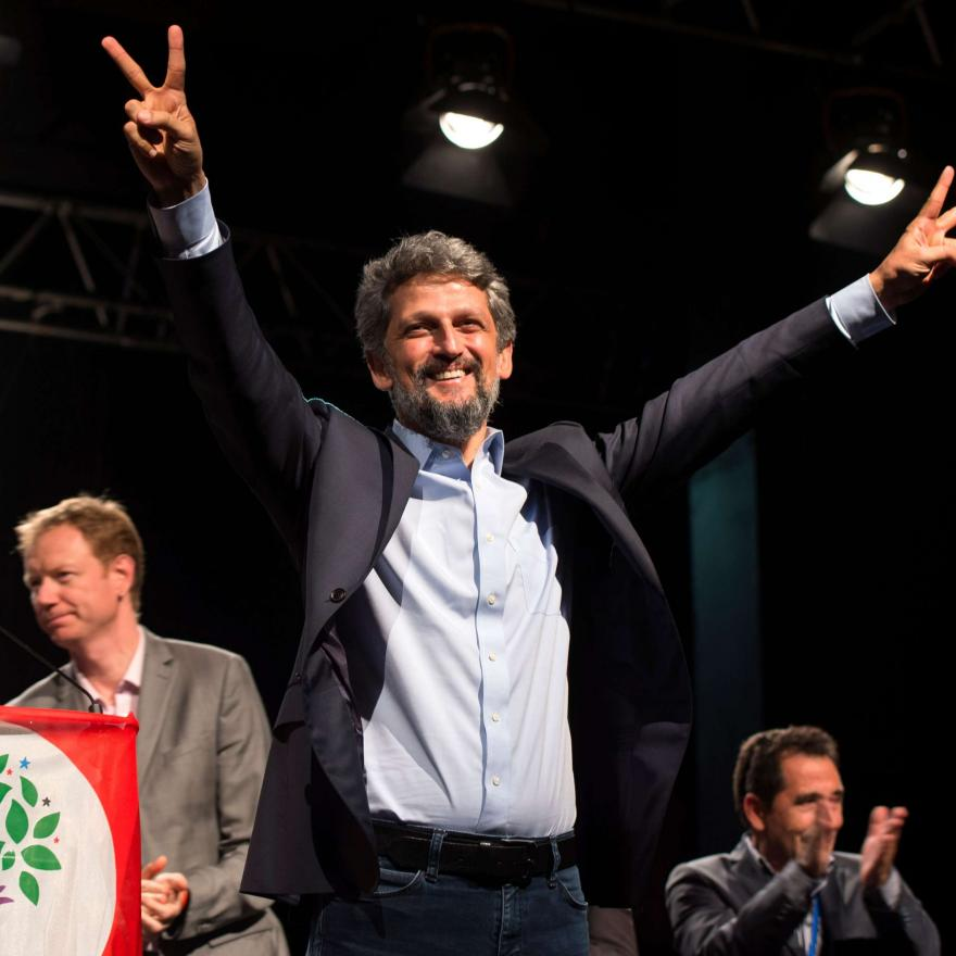 Turkish politician of Armenian descent and member of the Grand National Assembly of Turkey for the Peoples' Democratic Party (HDP) Garo Paylan (C) gestures as he attends a 'Stop Recep Tayyip Erdogan' meeting with members of the Armenian and Kurdish communities in Marseille, southern France, on June 1, 2018. / AFP PHOTO / BERTRAND LANGLOIS
