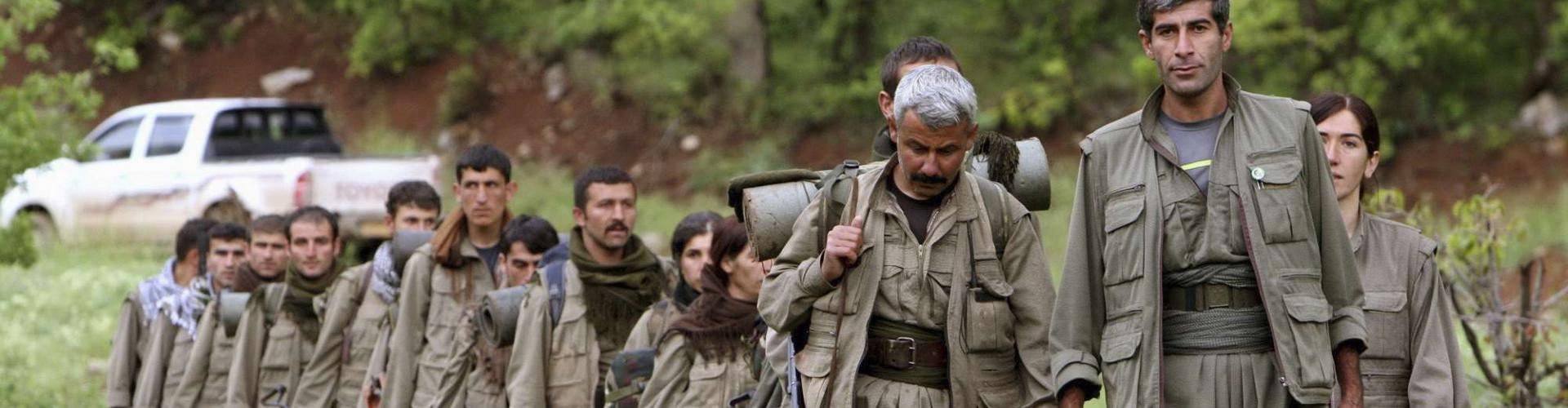 A group of armed Kurdish fighters from the Kurdistan Workers Party (PKK) enter northern Iraq in the Heror area, northeast of Dahuk in 2013. (AP)